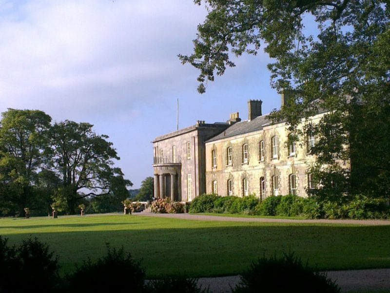 a picture of a Arlington court building surrounded by green gardens