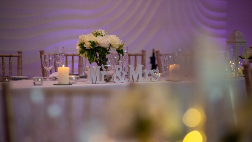a picture of a top table with mr and mrs ornaments