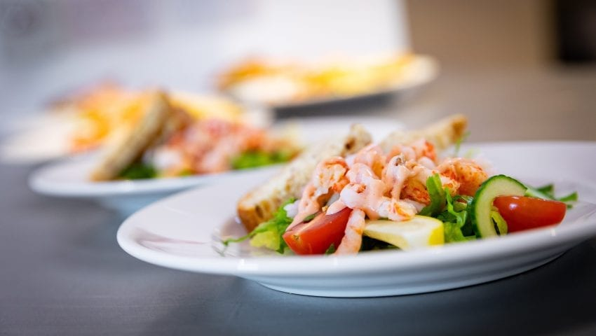 a picture of a plate of prawn salad with garnish