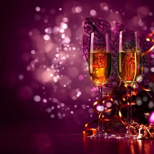 a picture of two glasses of champagne with a pink background