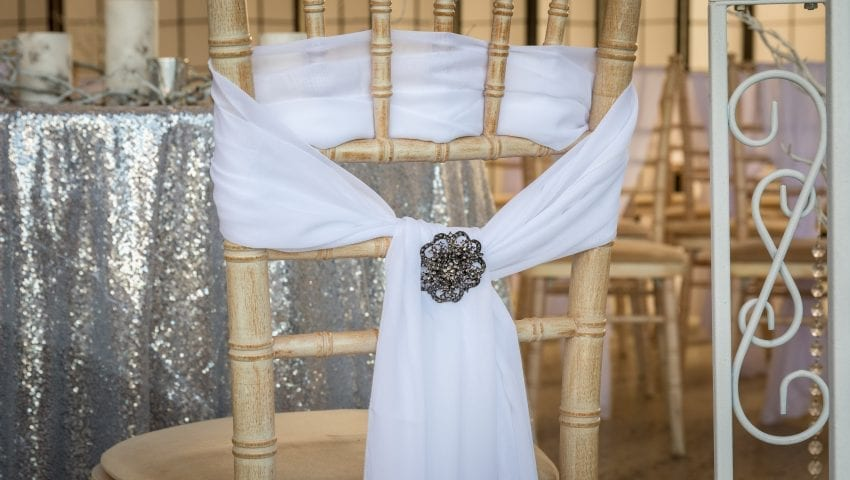 a picture of a decorated chair with a glittery table cloth in the background