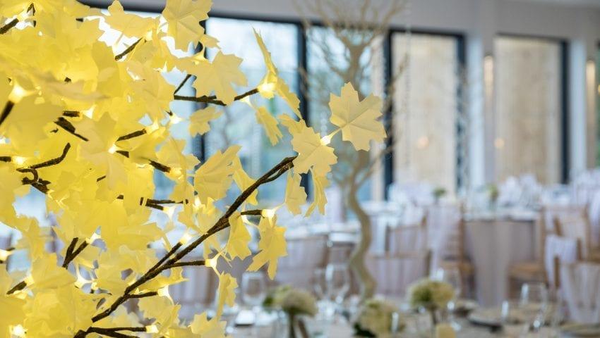 a close up of a lit white decorative tree