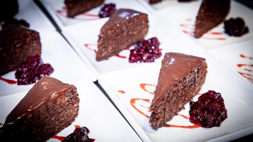 a picture of plates of chocolate cake and berries