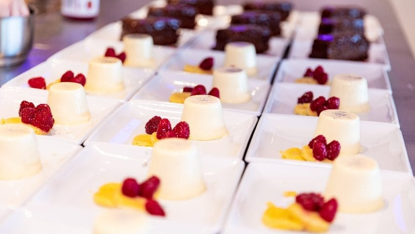 a picture of plates of pana cotta and chocolate cakes
