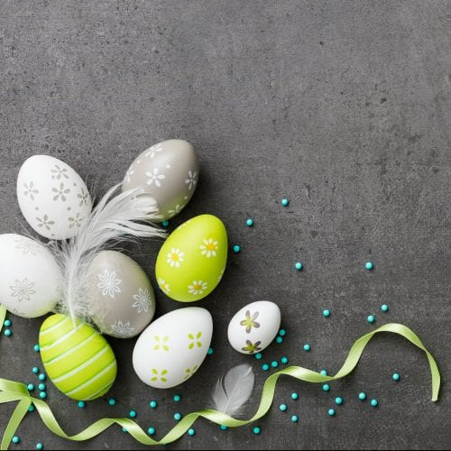 a picture of coloured decorated Easter eggs on the grey background