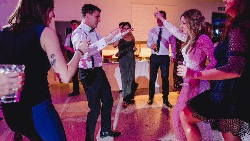 a picture of a group of people dancing at a wedding