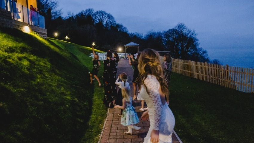 a picture of women outside getting ready to catch the bouquet