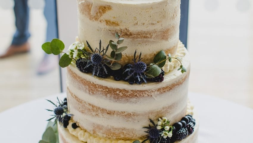 a close up picture of a 3 tier wedding cake