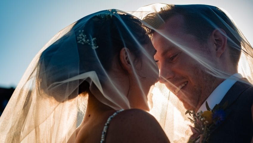 a picture of the bride and groom under her veil