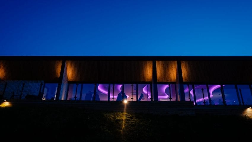 an outside view of the wedding venue with a disco inside