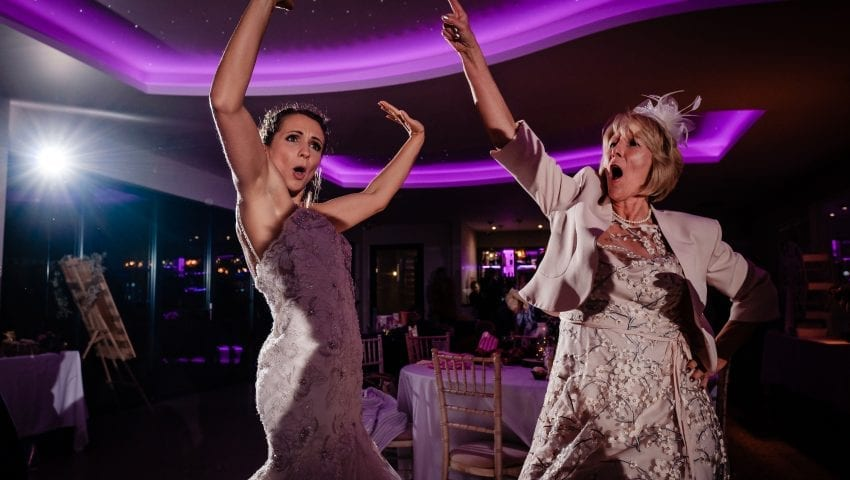 a picture of two women disco dancing
