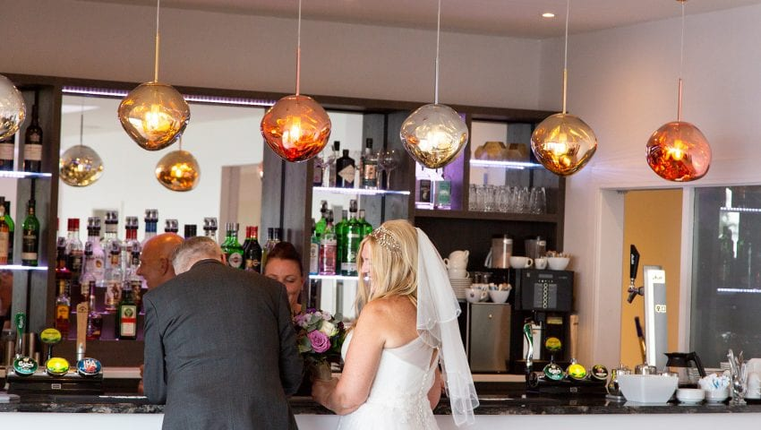a picture of the bride and groom at the bar