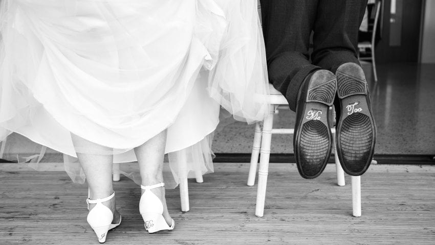 a picture of bride and groom shoes
