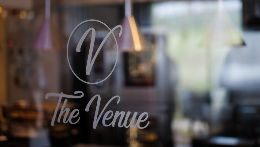 a picture of the venue logo on a glass window